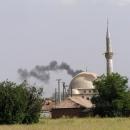 To naštěstí není hořící mešita, jen se za ní schovala čadící elektrárna
