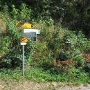 Hranici přejíždíme u Hohenbergu, kde začínají naše známé žluté cykloznačky.